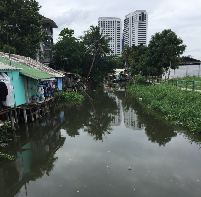 Thailand precarious housing on stilts over river